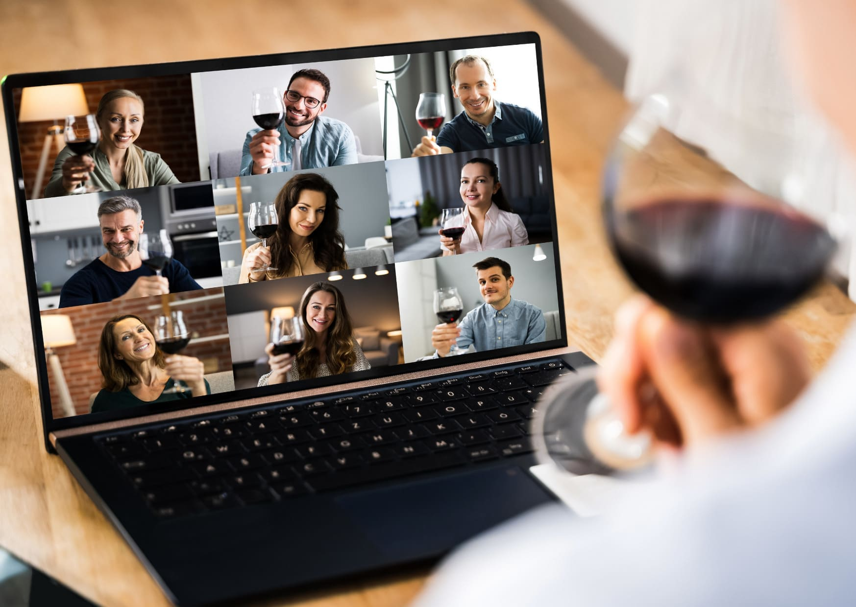 Remote wine tasting through a computer screen with several people